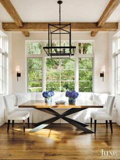 Country White Breakfast Area with Bronze Pendants | LuxeSource | Luxe Magazine - The Luxury Home Redefined