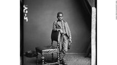 """1872, London: Kalulu (Ndugo M'Hali) was the personal servant and """"adopted son"""" of Morton Stanley, the British explorer and journalist. Kalulu was killed in central Africa in a canoe accident. Poised and elegant - click for long-unseen images of black people in Britain. Go to http://www.gettyimages.co.uk/detail/news-photo/studio-portrait-of-kalulu-8th-august-1872-kalulu-was-the-news-photo/513422707 for many different poses by Kalulu, some in """"native costumes"""""""