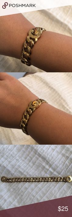 Marc Jacobs Gold Chain Bracelet Good condition. Has a little bit of discoloring on two of the links and on clasp. Pictured. Fits loosely on most wrists (my wrist is large) Marc By Marc Jacobs Jewelry Bracelets