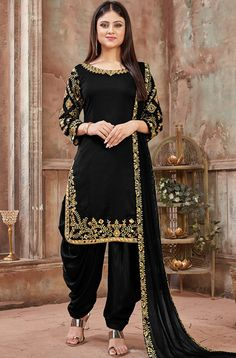 Black art silk patiala salwar kameez is beautiful jari embroidery with mirror work. Black color patiala dress is art silk fabric top and santoon fabric with net fabric dupatta. Black color punjabi dress online shopping at best prices. Pakistani Dress Design, Pakistani Dresses, Indian Dresses, Indian Outfits, Designer Kurtis, Designer Dresses, Designer Sarees, Designer Salwar Suits, Punjabi Suits Designer Boutique