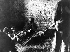 These five Germans were wounded and left without food or water for three days, hiding in a Normandy farmhouse waiting for a chance to surrender. Acting on information received from a French couple, U.S. soldiers went to the barn only to be attacked by snipers who seemed determined upon preventing their comrades from falling into Allied hands. After a skirmish, the snipers were dealt with and the wounded Germans taken captive, in France on June 14, 1944. AP Photo