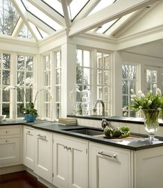 Hand painted pale cream cabinetry for this classic conservatory kitchen. Farmhouse Style Kitchen, Modern Farmhouse Kitchens, Rustic Kitchen, New Kitchen, Home Kitchens, Kitchen Decor, Dream Kitchens, Kitchen Ideas, Kitchen Designs