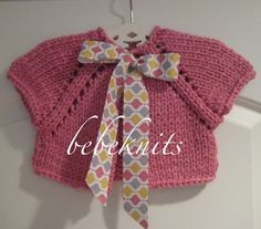 Hand Knit  Baby Cardigan in Pretty Pink. $35.00, via Etsy.