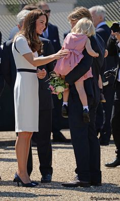 The Duchess with the little girl who was to present her with a bouquet of flowers, but became to shy - National Maritime Museum.