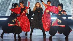 Madonna exposes fan's breast onstage