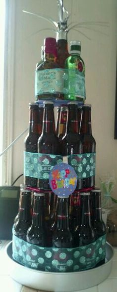 Beerfday cake! Made of favorite bottled beer or ale, top tier favorite alcohol.
