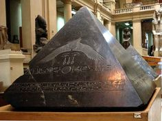 Pyramidion (top of a pyramid) dedicated by Amenemhet III , ruled 1831-1986 BC. The winged sun disk depicted in the centre of the stone, carving art on the black granite is amazing. Found among debri on the eastern side of the pyramid in 1900 the capstone of the pyramid was carved from a block of black granite. A pair of eyes similar to those on the eastern side if his sarcophagus, together with some other hieroglyphic components are inscribed on the eastern side of the capstone