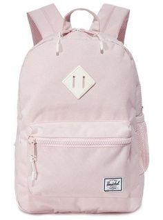 exclusive heritage backpack by Herschel Supply Co. A pastel-pink Herschel Supply Co. backpack with a mesh side pocket. A two-way zip opens to reveal the lined, two-pock. Mochila Herschel, Mochila Jansport, Herschel Backpack, Jansport Backpack, Herschel Heritage Backpack, Backpack Bags, Stylish Backpacks, Cute Backpacks, Girl Backpacks