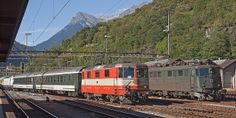 SBB CFF FFS 11109 (Swiss Express livery) hauls the test run with the Siemens Vectron by side the in Biasca
