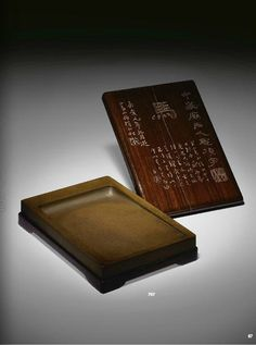 A yellow Chengni inkstone from the former collection of Huang Yi, with Huang's inscription on box's cover, mid Qing dynasty