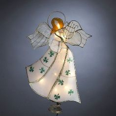 $33.89-$30.00 Kurt Adler 9-1/2-Inch Plastic Angel with Harp and Shamrock Design Treetop - This Kurt Adler 9-1/2-Inch plastic angel with harp and shamrock design treetop is a fun twist on a classic way to accent your Christmas tree. This tree topper features a simple, glowing likeness of an angel, detailed with a 3-string harp, and wearing a white dress accented by green shamrocks. This Irish ang ...