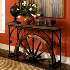 Have to have it. Winchester Wagon Wheel Console Table $1499.99