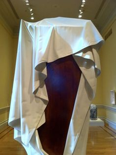"""""""Ghost Clock"""" by American sculptor Wendell Castle Pic 2 of 3  At first glance, Ghost Clock appears to be a grandfather clock draped with a large white sheet, and tied with a rope. On closer examination, one finds it all to be carved from a single block of bleached Honduras mahogany..."""