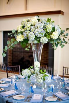 I like the blue things the candles are in and the hydrangea arrangement could work for a gift table or head table