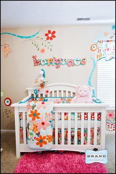 Love the colors and the wall stenciling. There are additional pictures of the nursery.