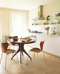 round table, open shelves, bent wood chairs