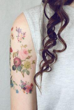 A lot of Little Aquarelle Flower Tattoo on Shoulder