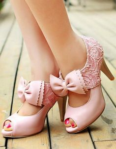 Pink peep toe pumps with bows