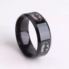 New Unisex Batman Band Ring Size 11 Show off your favorite superhero with this classic stainless steel ring that features the iconic Batman symbol. ~ Black with silver Batman symbol ~ Stainless steel ~ Comfort fit band measures wide Batman Ring, Silver Batman, Black Batman, Black Band Ring, Black Rings, Stainless Steel Wedding Bands, Stainless Steel Rings, Rose Gold Engagement Ring, Engagement Ring Settings