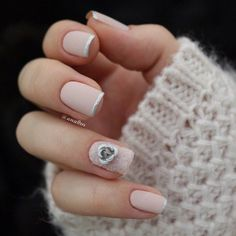 Simple yet classic French tip of nude and silver polish finished with a silver fall flower on top.