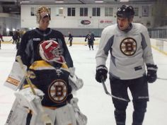 9 year old Make-A-Wish patient Maddie SanTosuosso practices with the Bruins at Ristuccia Arena. Tuukka Rask and Milan Lucic