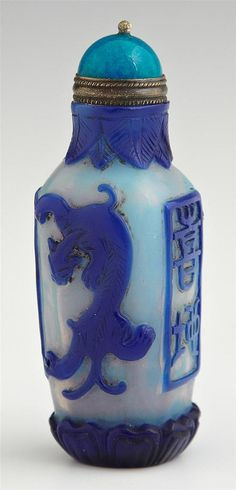 Chinese Opalescent Peking Glass Snuff Bottle, c. 1900, of square bottle form, with blue overlay of Imperial dragons and seals, from the Christian collection,