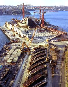 Sydney Opera House construction progress from Unilever House roof shows Hornibrook cranes, July 1964. Max Dupain photo.