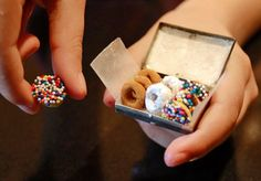 teeny donuts! (actually half-dipped cheerios in a lined matchbox). Why? Because they're cute :).