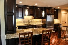 Beautiful mottled granite countertops. Full kitchen installation in the North Hills.
