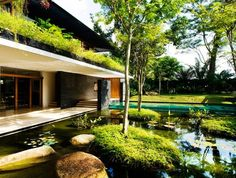 Green-Roofed Cluny House Showcases Low-Energy Luxury in Singapore