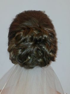 Bridal hair created to place the veil below the hair style!
