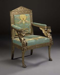 AN ITALIAN EMPIRE CARVED GILTWOOD ARMCHAIR Attributed to Lorenzo Santi (d.1839), ROME, first quarter 19th centuryThese temple-pedimented seats were almost certainly commissioned for the Palazzo del Buffalo-Ferraioli, the Rome palace of Emperor Napoleon's uncle Joseph Cardinal Fesch (d.1839), who had been appointed in 1803 as Ambassadeur de France aupres du Saint-Siege and Minister Plenipotentiary to the Holy See.
