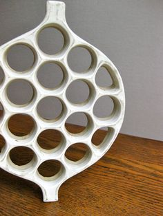 White, round trivet.  Nice piece of midcentury American ceramics, made by David Gil of the Bennington Pottery, in Vermont, in the 1960s.  10 1/2 by 7 3/4. Good condition, with rubber feet still intact. **Note: actual piece is cleaner that it appears in photos!**  Shipping overages of more than $2.00 will be refunded.  We do ship internationally. Please convo us for cost to you.  Please see more items in our shop: https://www.etsy.com/shop/TheJoeKnoxCompany?ref&#x...