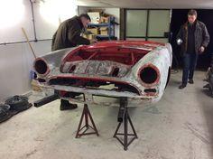 Restoration expert Jonathan and Paint finish maestro Neville carefully inspect the shell