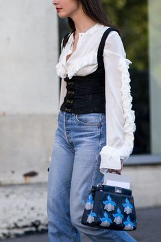 Street style from SS17 New York Fashion Week. Your style takeout? Bodice tops are the new spaghetti strap vests: wear them over tees and ruffled shirts