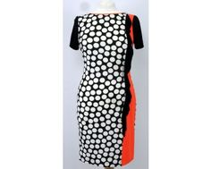 This fun little dress from Apanage comes in 3 different colours pink, orange and green. It has a coloured panel to the side trimmed with a frill. Piping along the neckline matches the panel colour. Shop now at www.middeltonwood.co.uk in sizes 12-18 in green, Only a 10 in orange and 16-18 in pink.