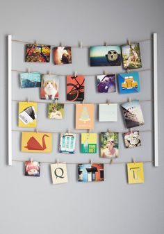 Hang up all your memories with a simple clothesline hanger kit. | 27 Easy Ways To Make Your Dorm Room So Much Better