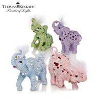 Limited-edition, elephant figurines with ornate designs, colorful accents, Swarovski crystals, high-gloss finishes and the artist& signature lantern. Colorful Elephant, Elephant Love, Elephant Art, Elephant Stuff, Elefante Hindu, Sugar Skull Artwork, Elephants Never Forget, Elephant Figurines, Thomas Kinkade