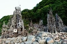 """On July 30. 1980, Lars Vilks began building a series of sculptures made of driftwood in the nature reserve Kullaberg, in the northwest corner of county Skåne. A few days later the sculpture was named """"Nimis""""."""