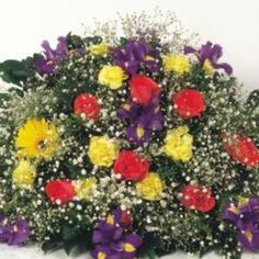 Use silk flowers to create a long-lasting headstone saddle arrangement.