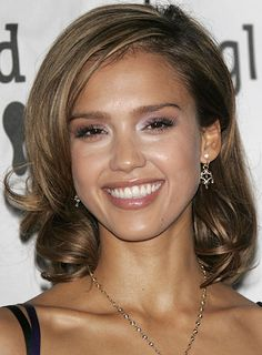 Jessica Albas girl next door curly do is an amazing option for a fun twist on naturally straight or wavy hair.