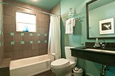 tiles and wall color divide tub from rest of bathroom