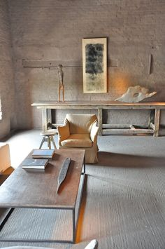 """by Lovenordic Design Blog.  Like this as """"bones"""". - would add a rug under coffee table, plant on back table, green glass bottle on coffee table...maybe a stack of leather books on back table"""