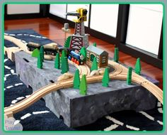 "Play Trains!: Recycle old cardboard boxes to make platforms for wooden train layouts ("",)"