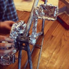 how to prep your bike for new paint- wrap foil over whatever you don't want paint on