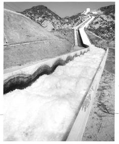 View of the Cascades, bringing water from the Owens Valley into the San Fernando Valley. Department of Water and Power number 70-1270. Black and white photograph, 8 x 10 in.