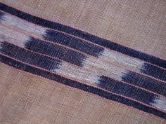 HAND-KNOTED BASHO-FU  KASURI-RESISTED HANDSPUN COTTON  DYED WITH SAFFLOWER AND RYUKYU INDIGO  TAKETOMI-JIMA, OKINAWA, LATE 19C/EARLY 20C. Te-saji hand towels of basho-fu were traditionally woven by young women in the Yaeyama archipelago of Okinawa and given to their suitors as a symbol of love and commitment.