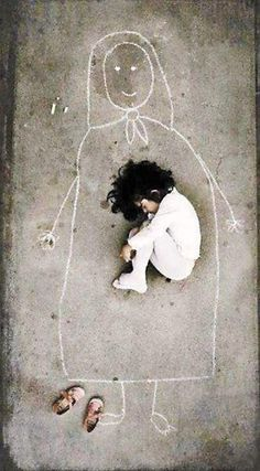 this little girl, an Iraqi orphan, missing her mother, drew her, and fell asleep inside her chalked form....heartbreaking ..and how many other orphaned or injured children languish there a result of neocon lies and wars for oil?