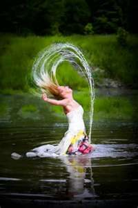A free spirit bride takes to the water in her wedding gown - the day after!