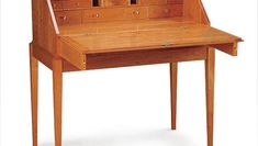 Woodworker: Martin Milkovitz This cherry writing desk, 22 in. deep (when closed) by 43 in. wide by 46 in. tall, has 11 interior drawers and two exterior ones. It also has six secret compartments and...